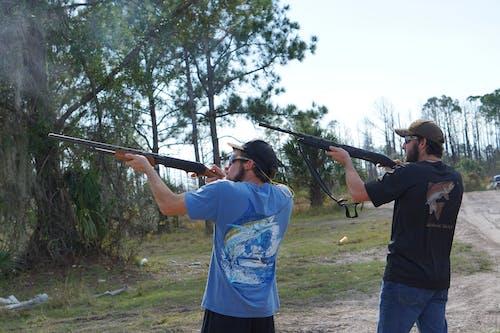 Foto d'estoc gratuïta de argila, caça, diumenge dia de diversió, escopeta