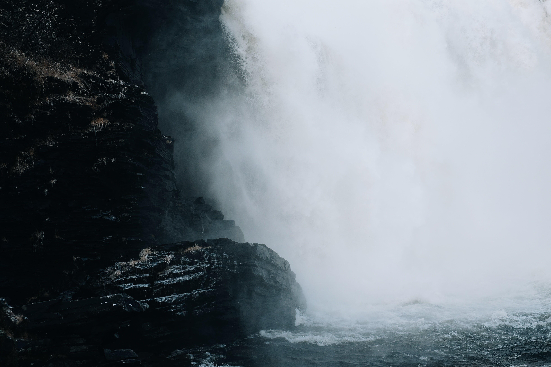 Black Rock Formation Beside Waterfalls