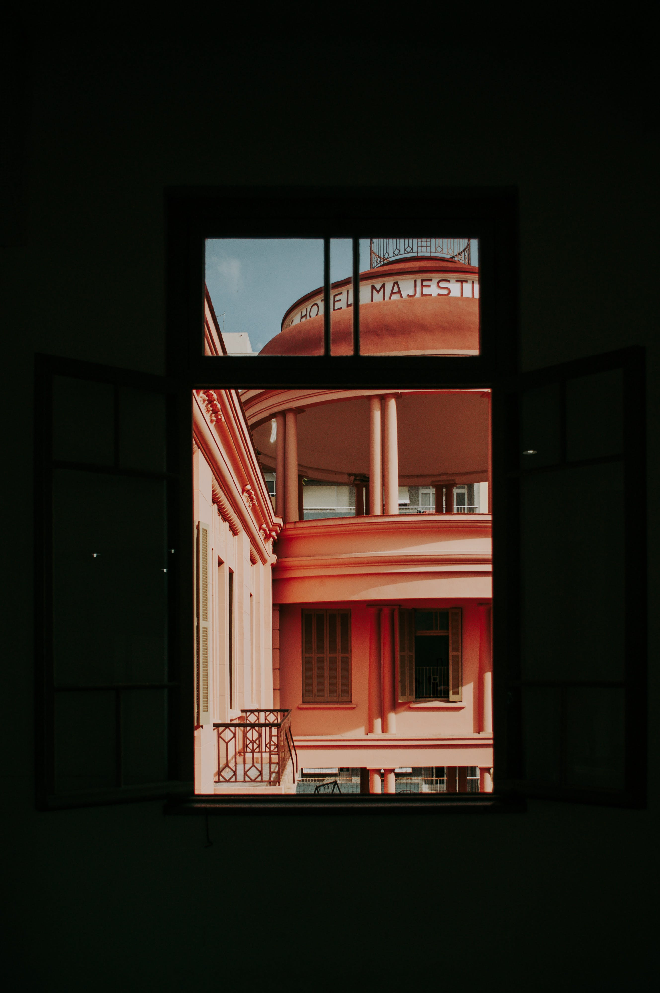 Orange Painted Building Through Window