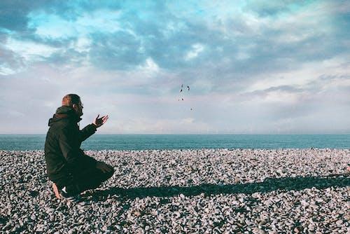 Man Throwing Stones