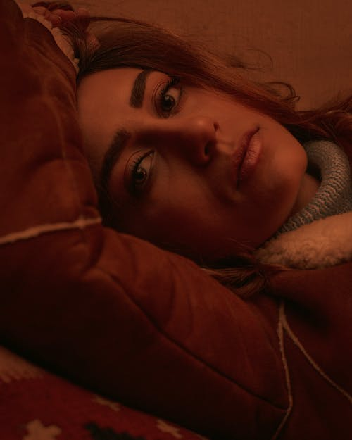Close-up Photo of Woman in Jacket Lying Down