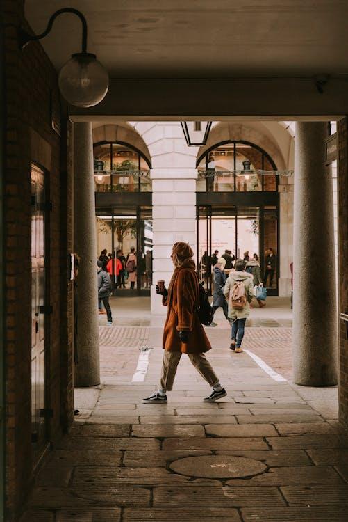 Woman Walking Through Building