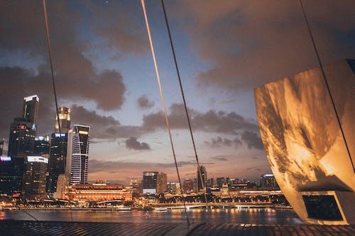 Безкоштовне стокове фото на тему «архітектура, берег, будівлі, Захід сонця»