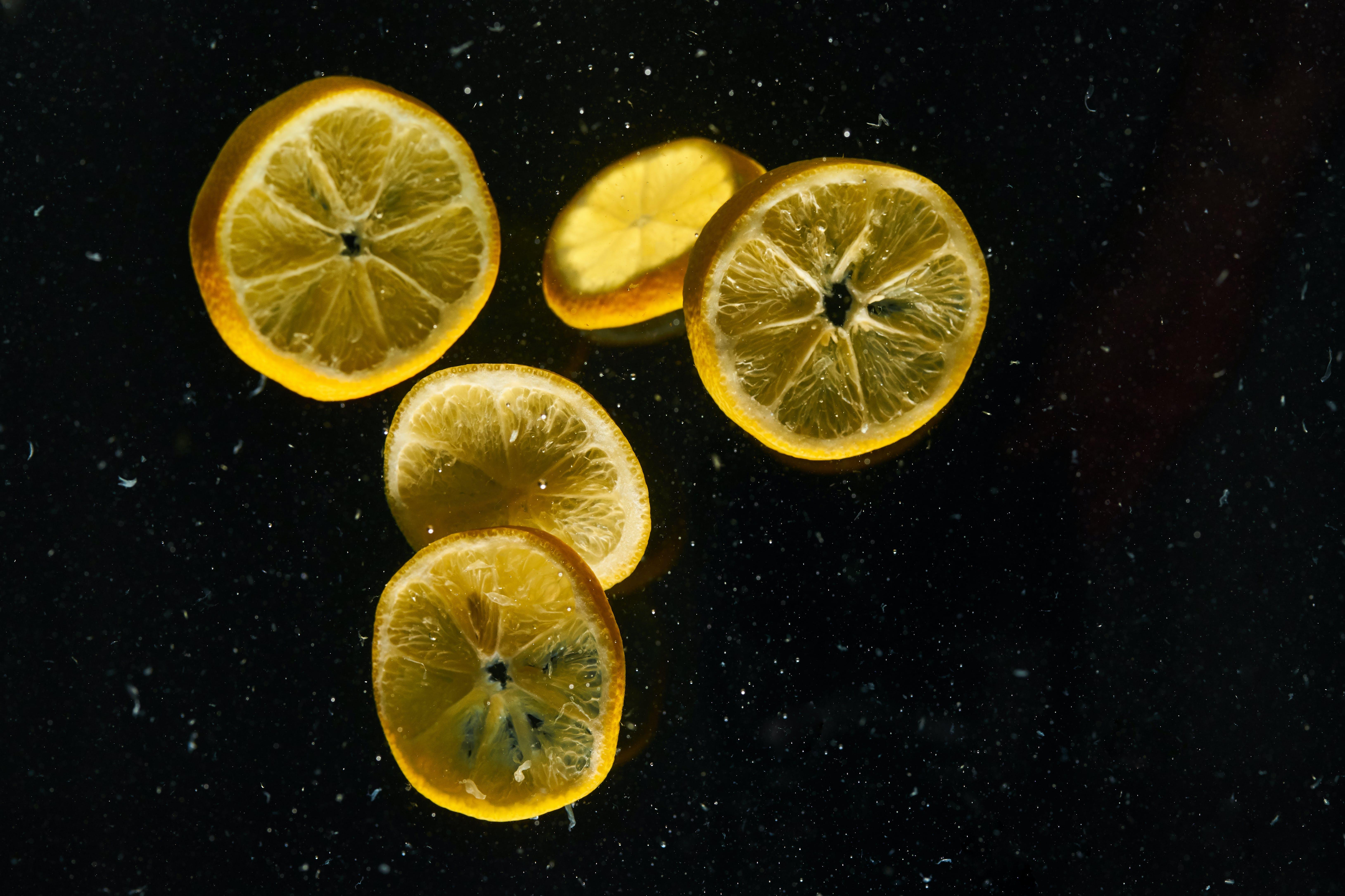 Sliced of Lemons on Black Surface