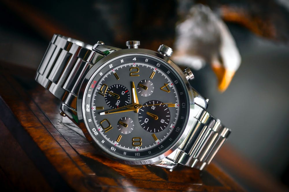 A black round chronograph watch. | Photo: Pexels