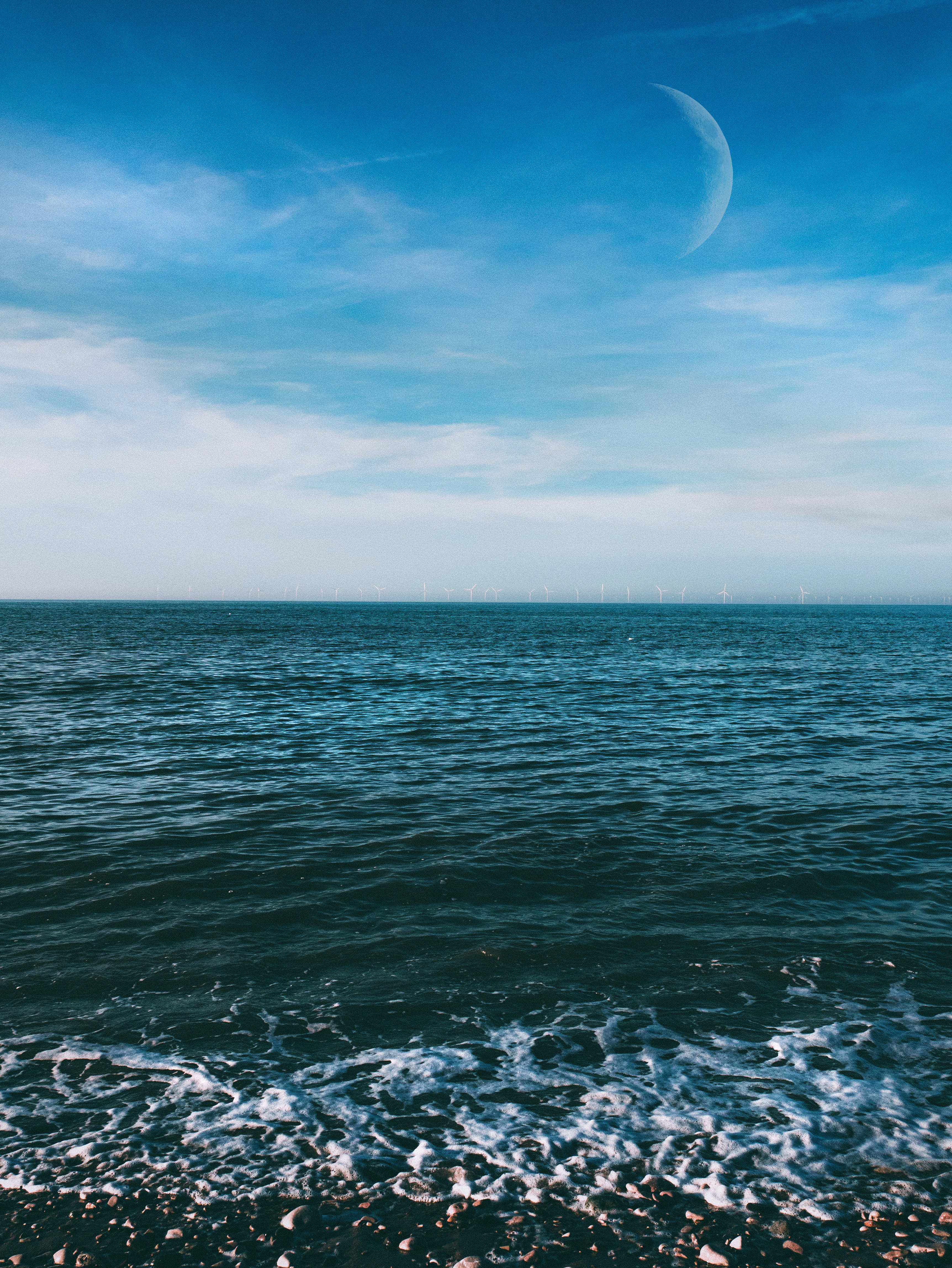 Calm Body of Water Under Blue Sky