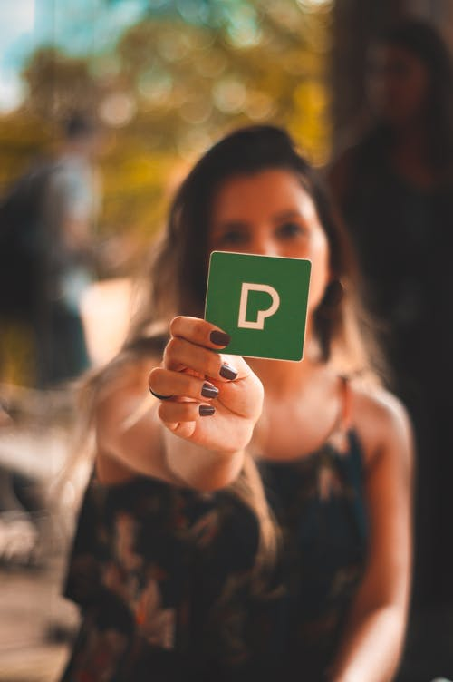 Person Holding Green P Card