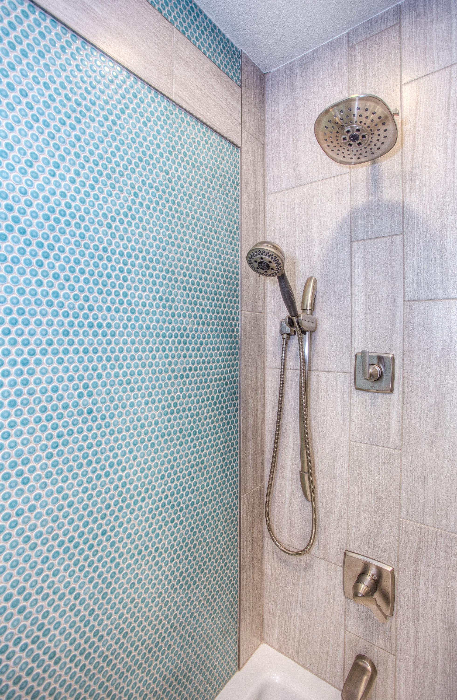 stainless steel shower head inside bathroom · free stock photo