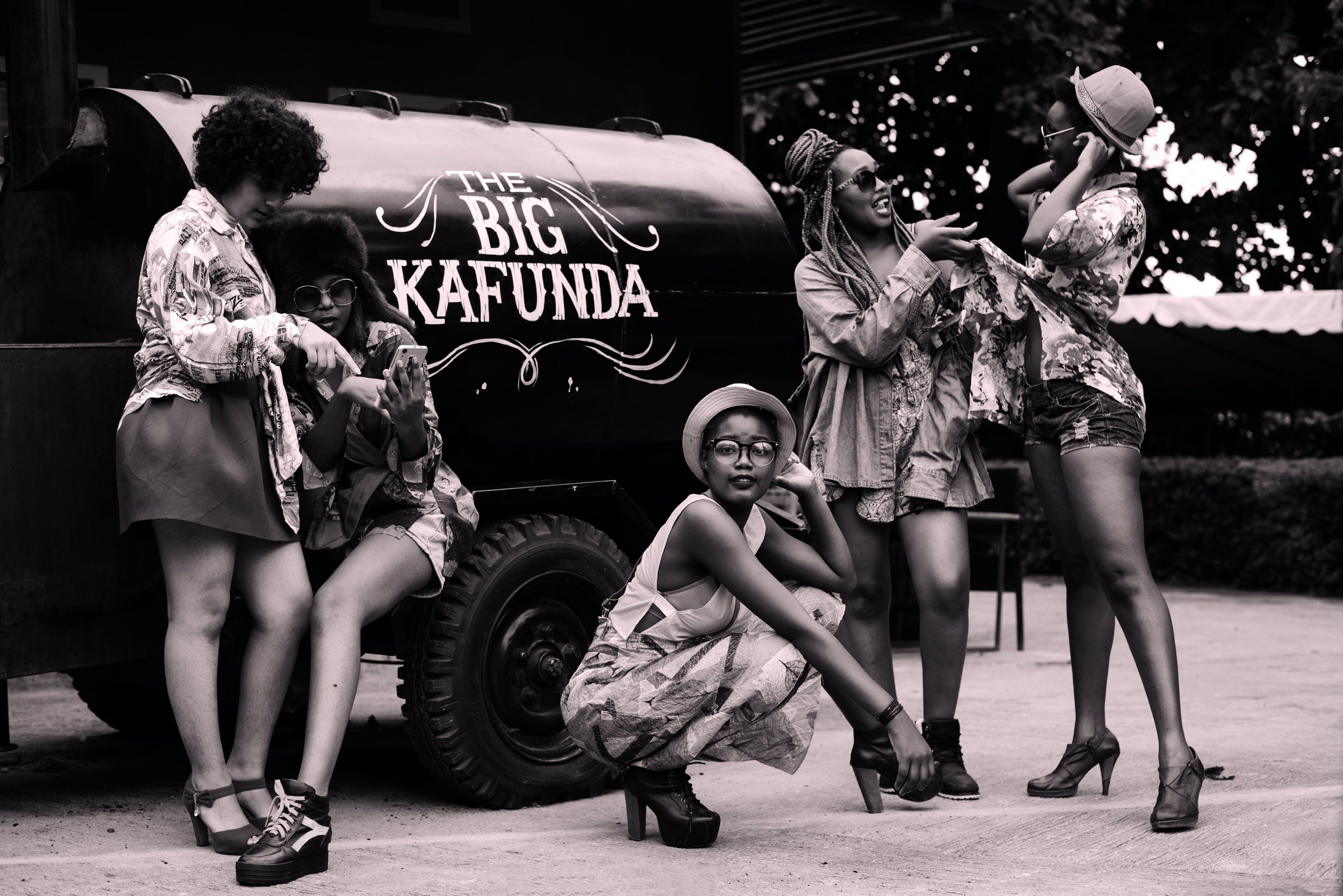 Women Standing Near the Big Kafunda Truck