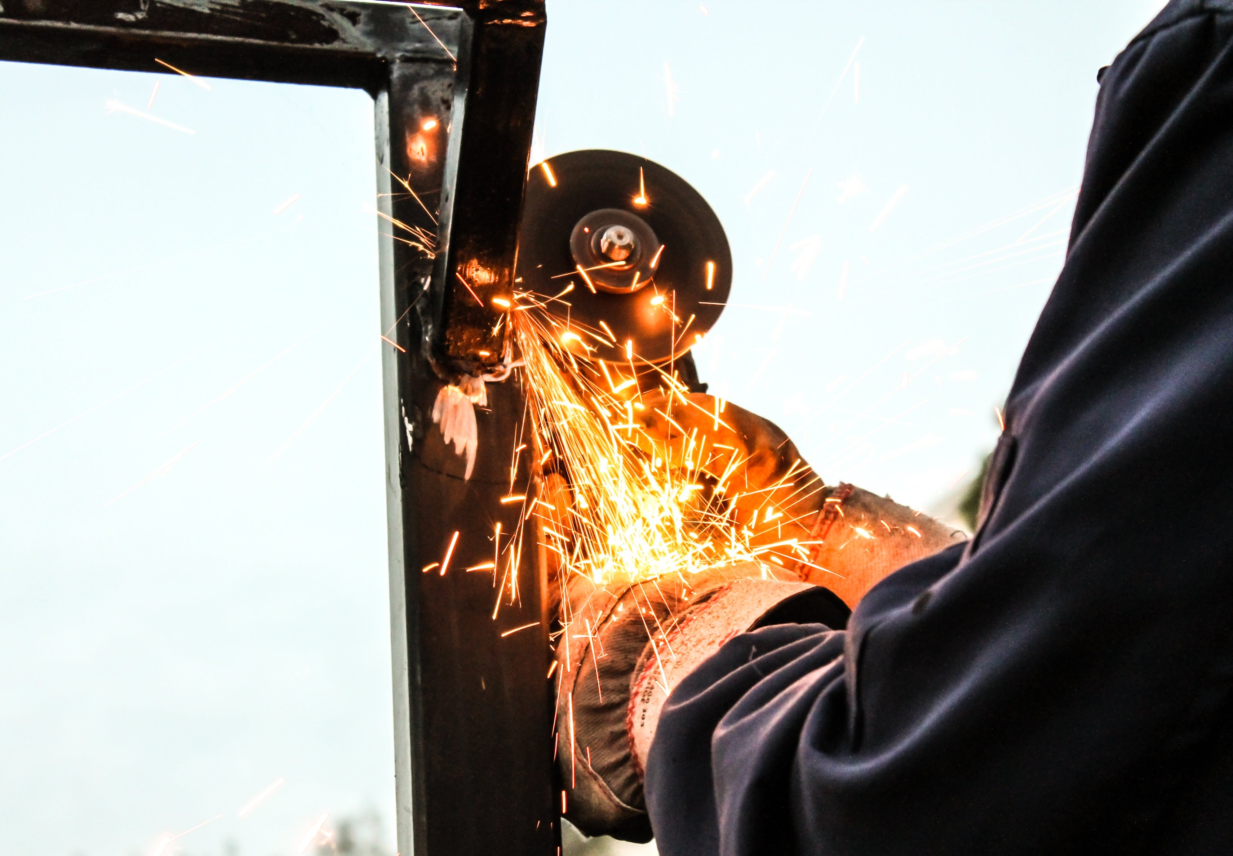 Person Holding Angle Grinder