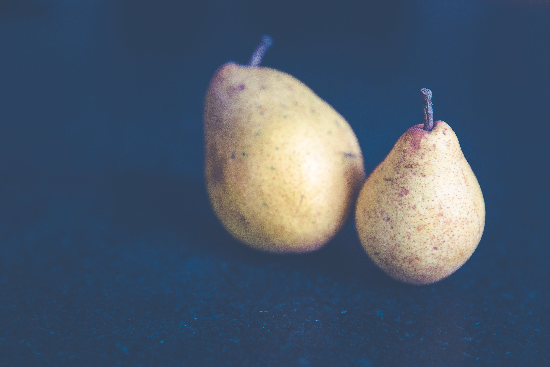 Tilt Shift Photo of Two Pears