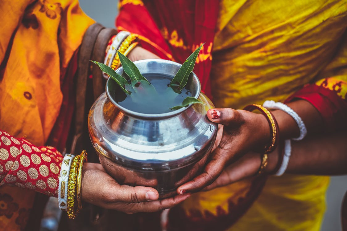 People Holding Silver Metal Pot