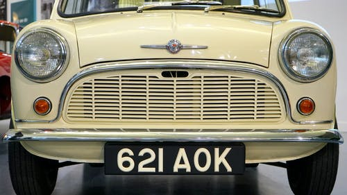 Yellow Classic Car With 621 Aok Licensed Plate