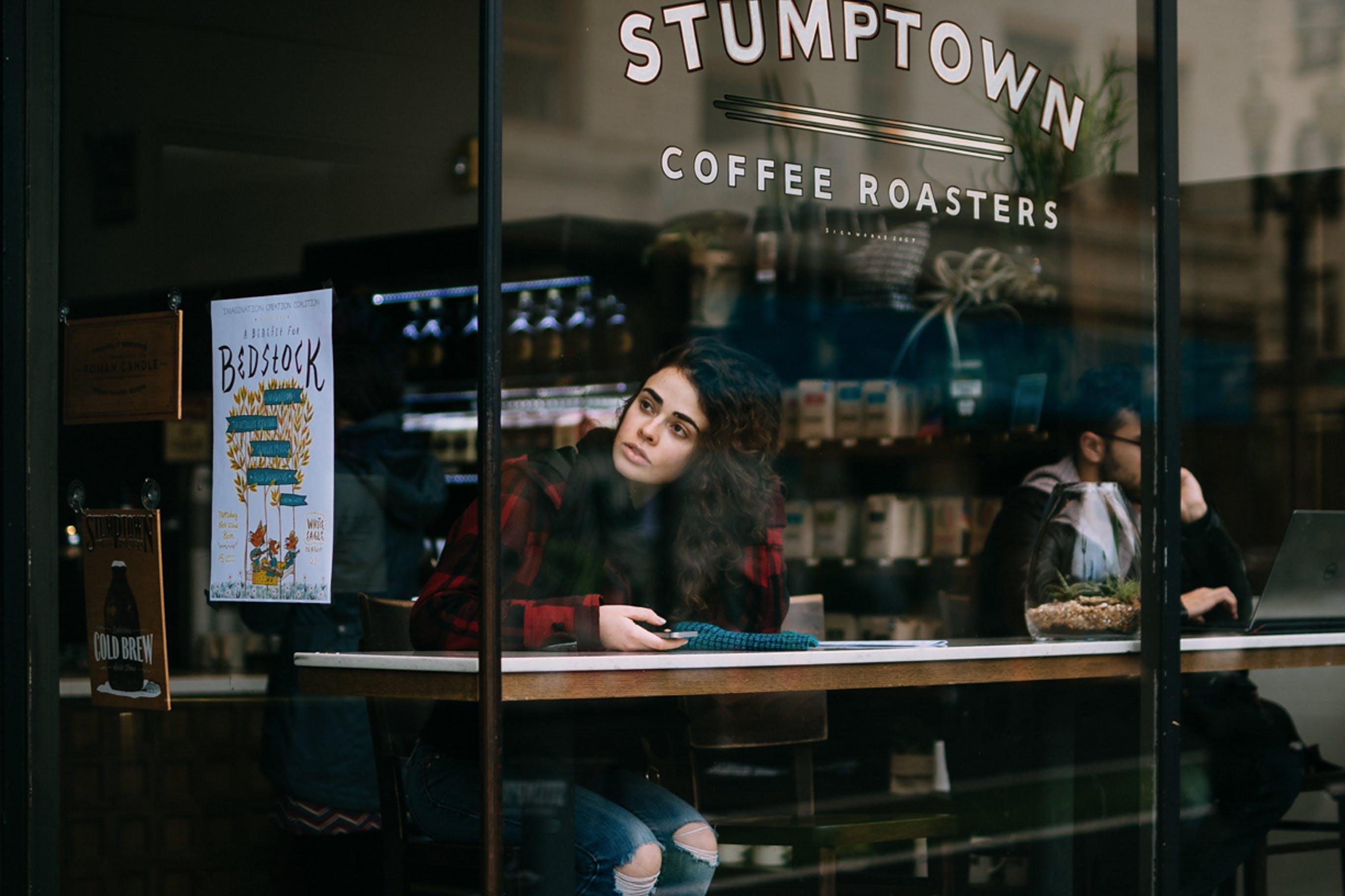 Woman Sitting Inside Stumptown Coffee Roasters