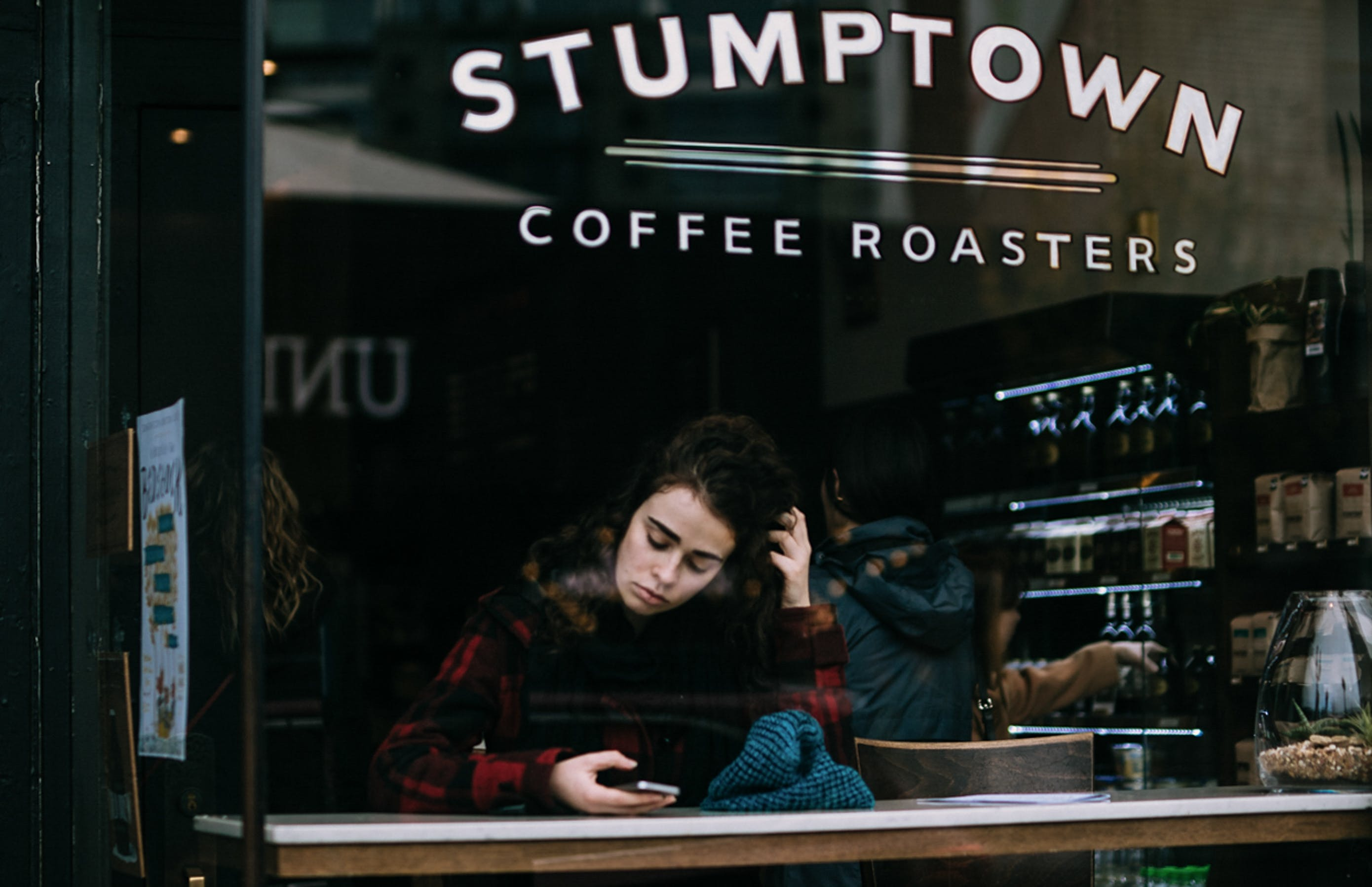 Woman Sitting Inside Stumptown Establishment