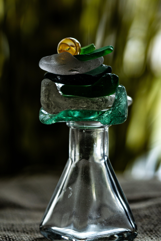 Základová fotografie zdarma na téma plážové sklo, stoh, zelená