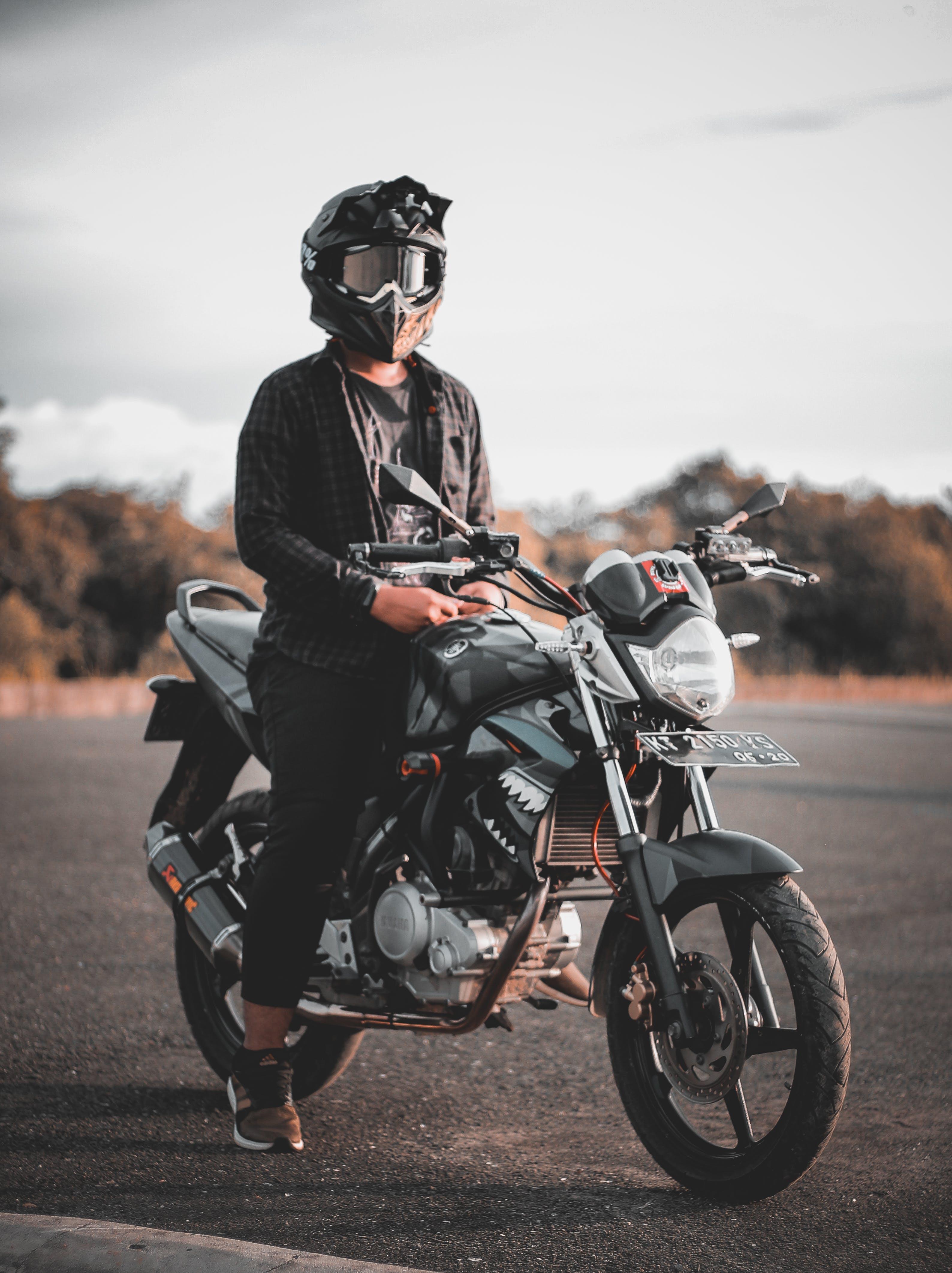 Man Riding Gray Backbone Motorcycle