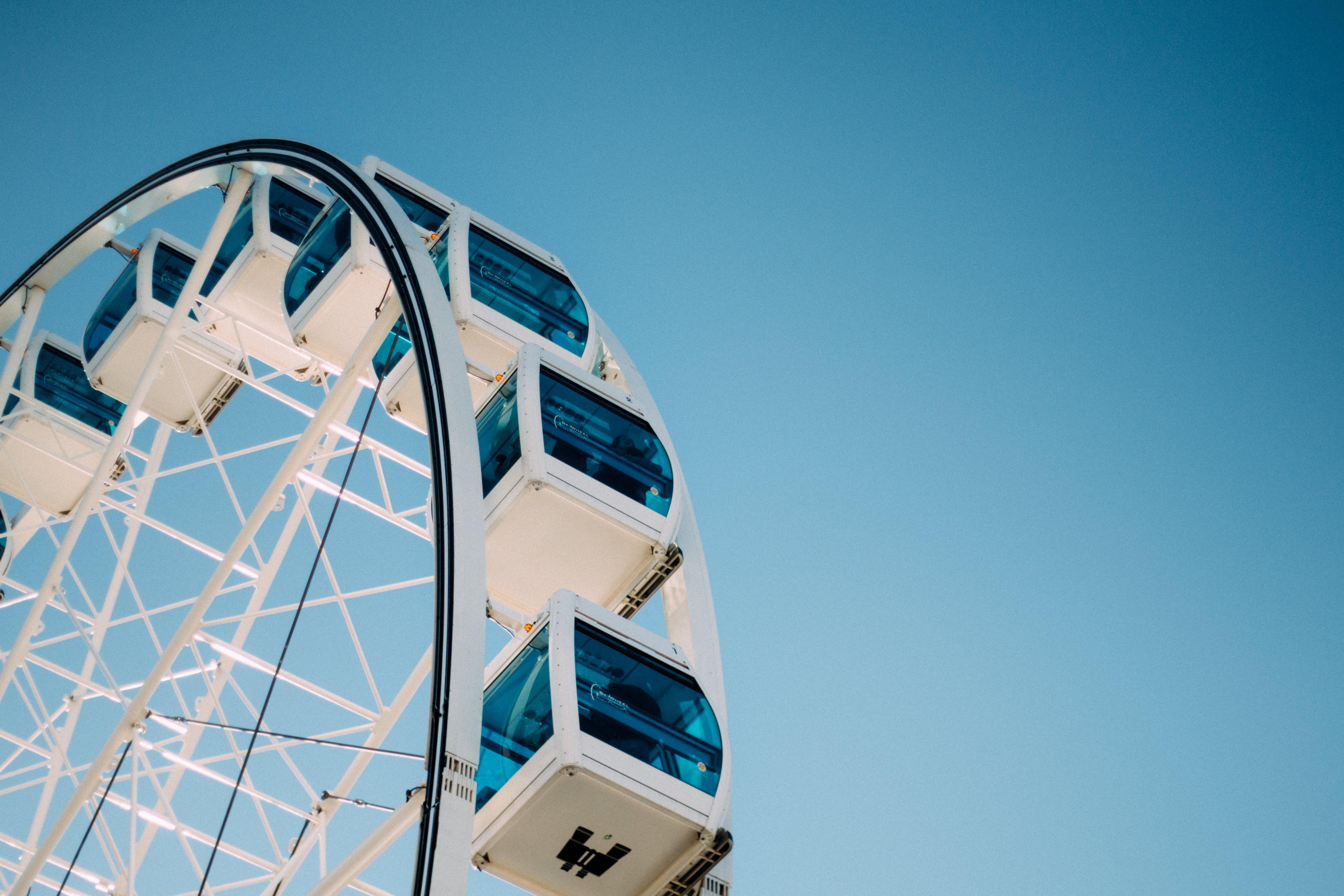 Blue and White Ferries Wheel Under Blue Skies