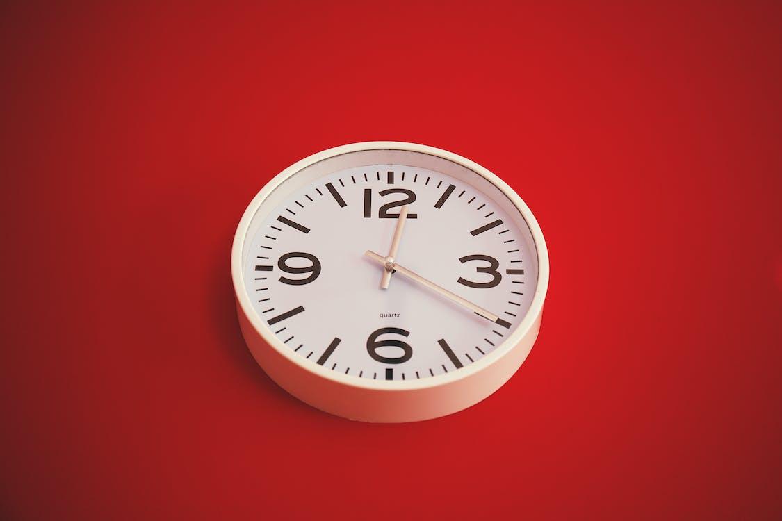 Round White Analog Wall Clock Displaying 12:20