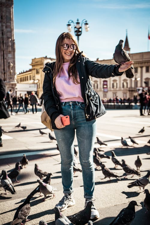 Smiling Woman With Pigeon on Hand