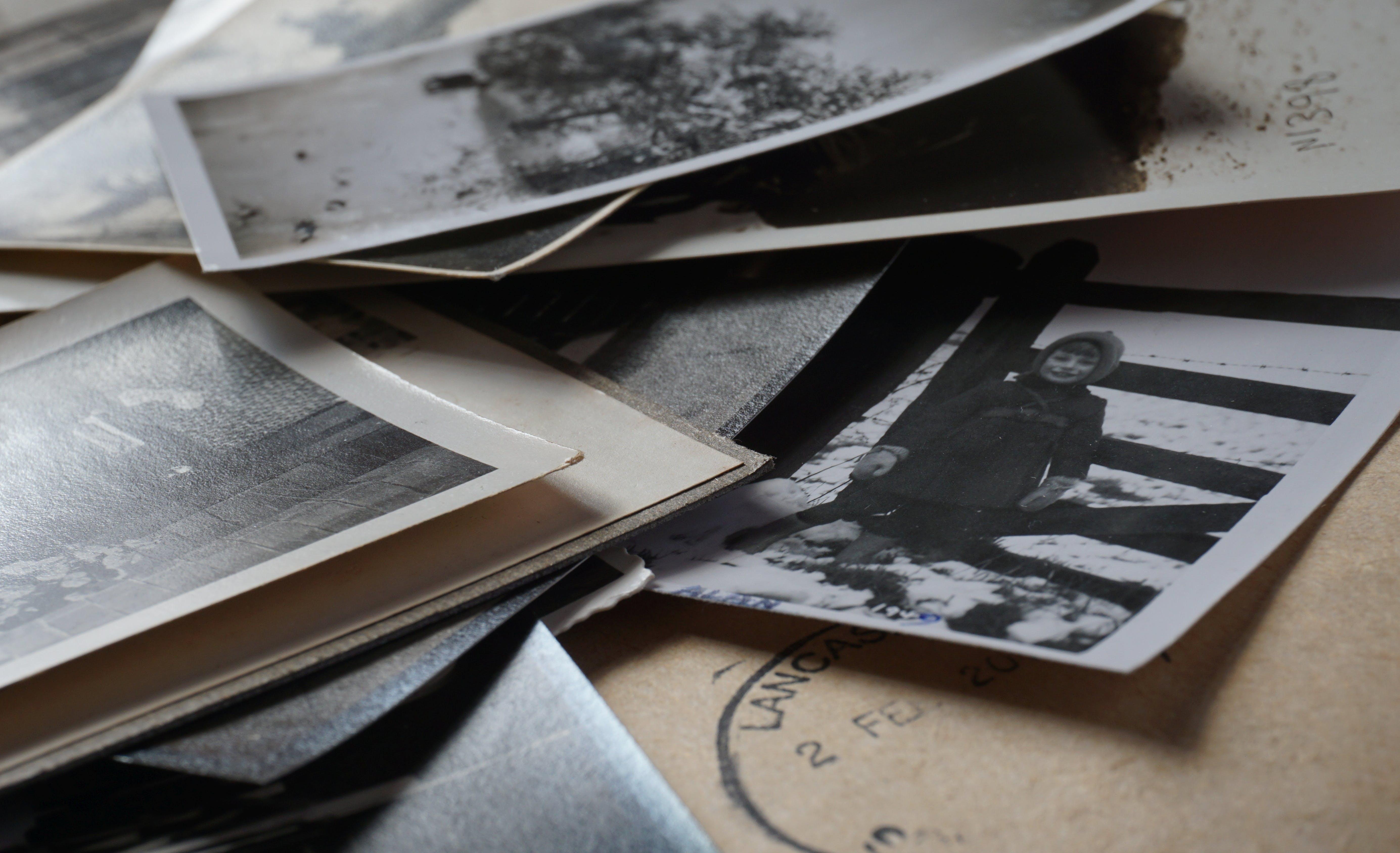 Polaroid Photos on Wooden Surface