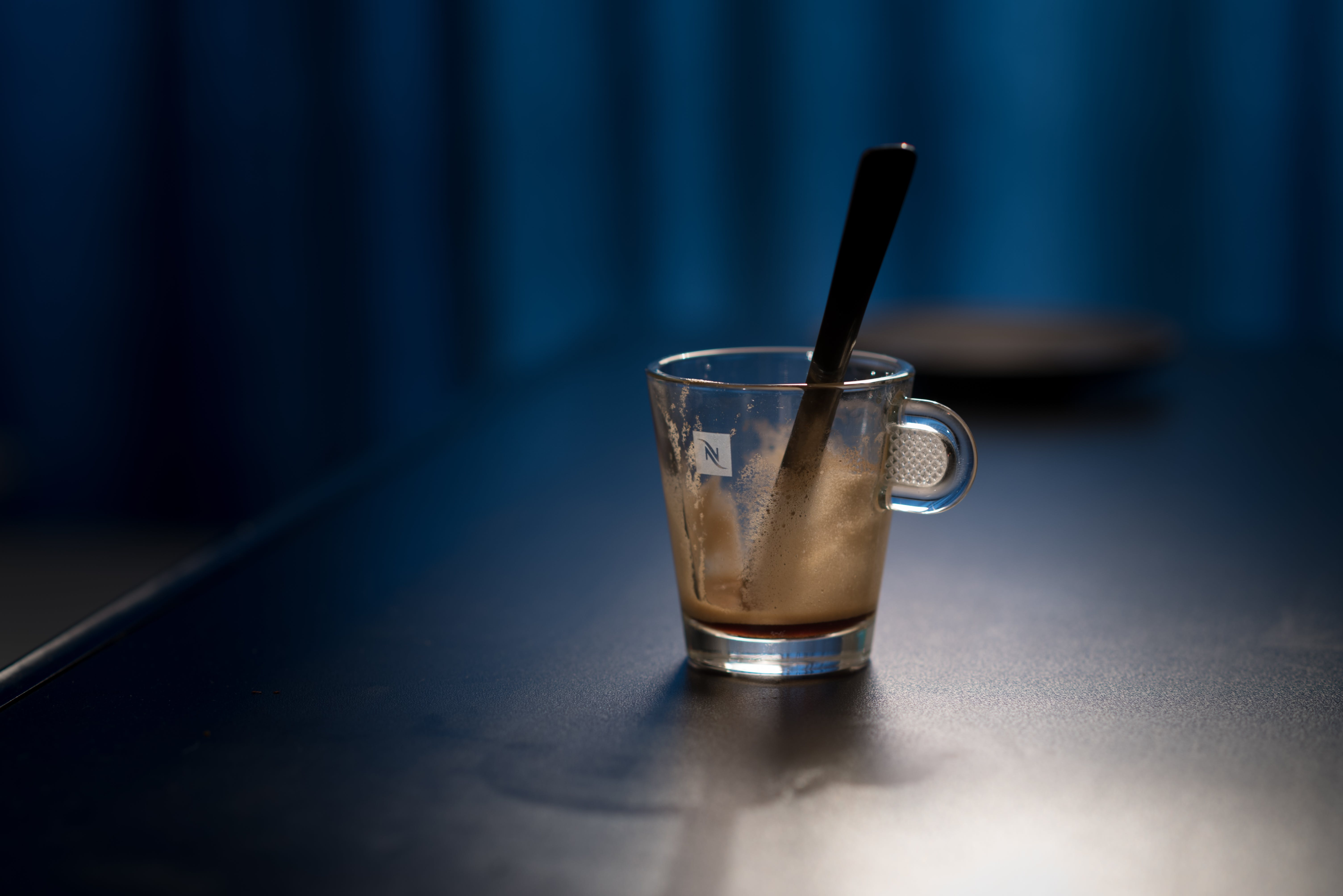 Black Stirring Rod on Clear Glass Cup