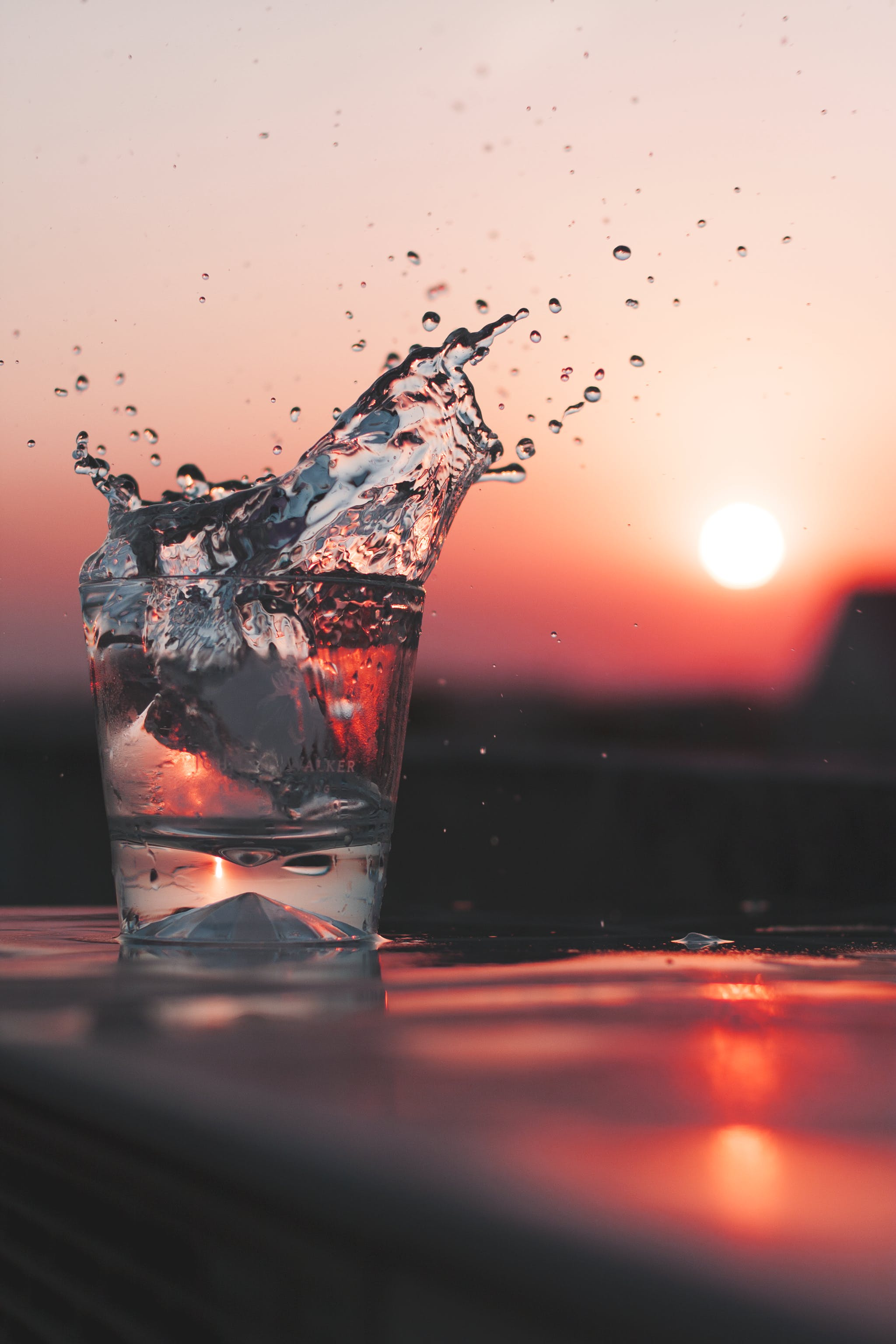 A Glass of Water and a Red Sun
