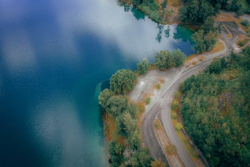 Aerial View Photography of Roadway Near Lake