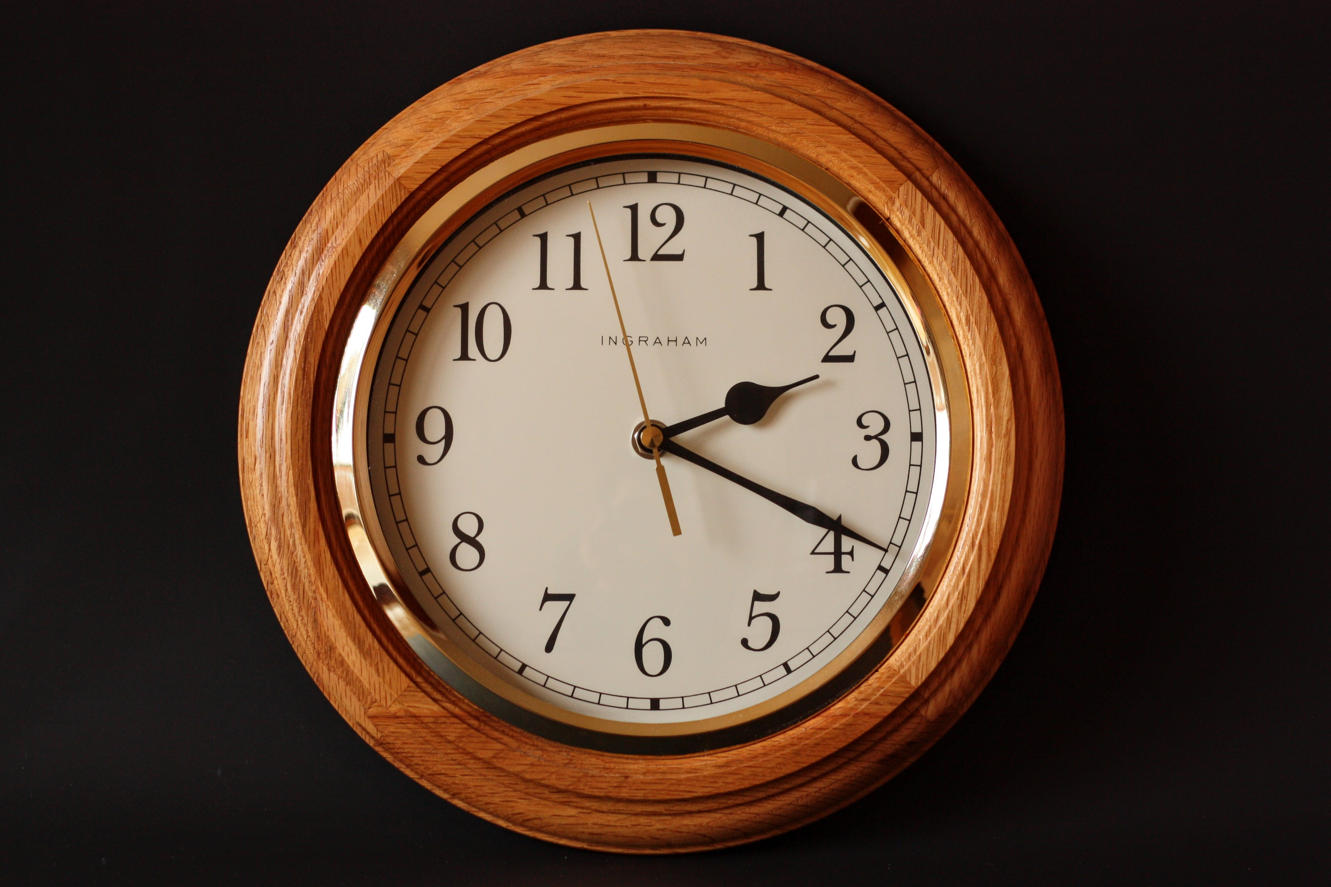 Brown Wooden Framed Clock Showing 2:19