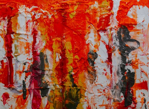 Red, Yellow, and Black Abstract Painting on White Canvas