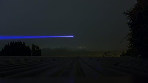 Photos gratuites de bluelaser, brouillard, clairière, laser
