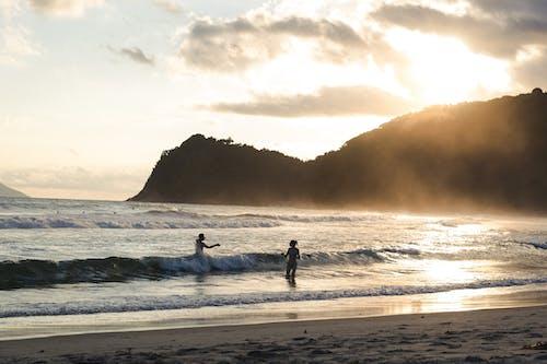 Foto d'estoc gratuïta de agenda, aigua de mar, centellegi del sol, llibertat