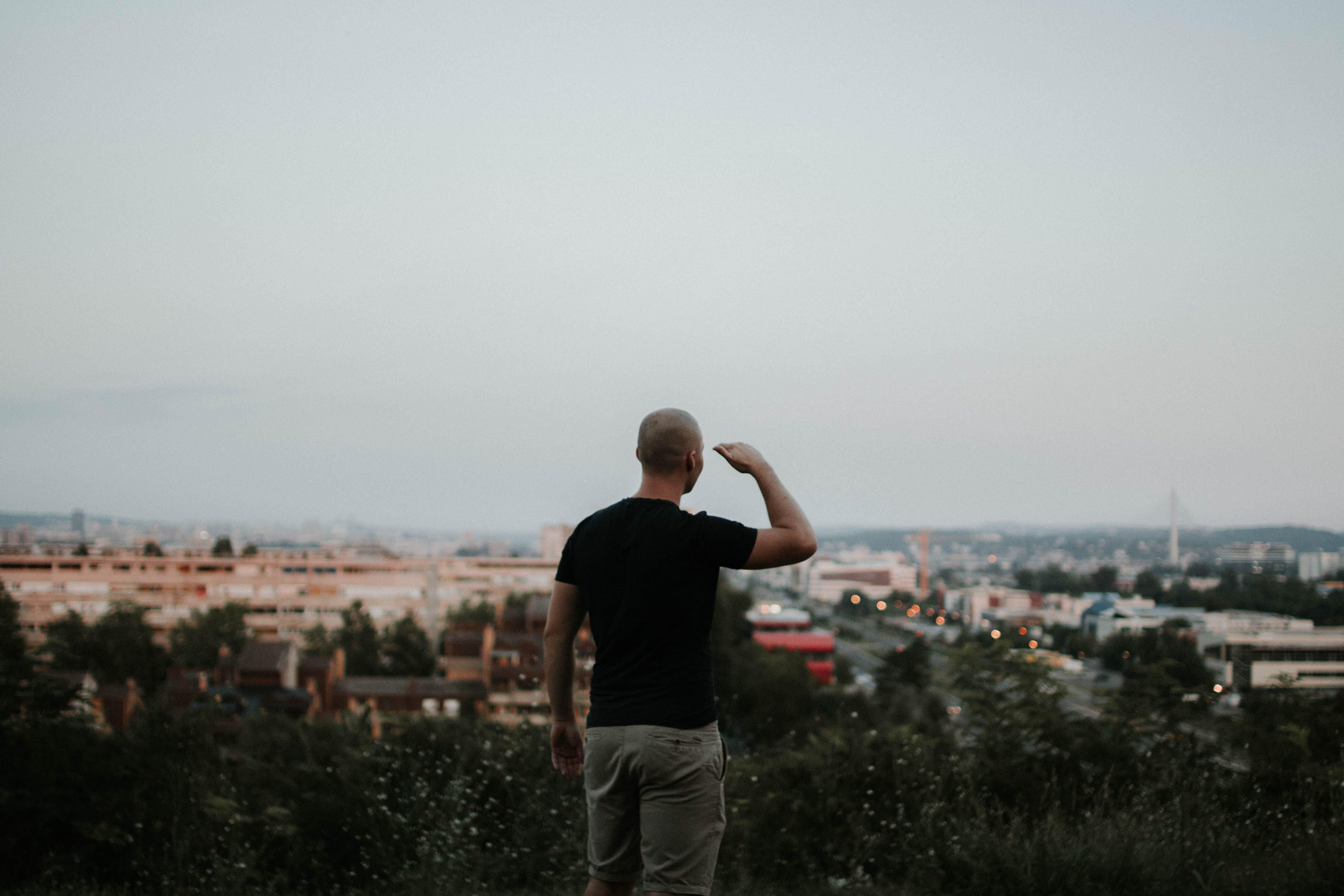 Man Looking Towards the City
