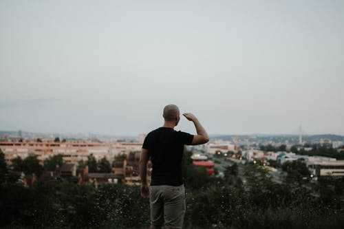 Man Looking Towards the City