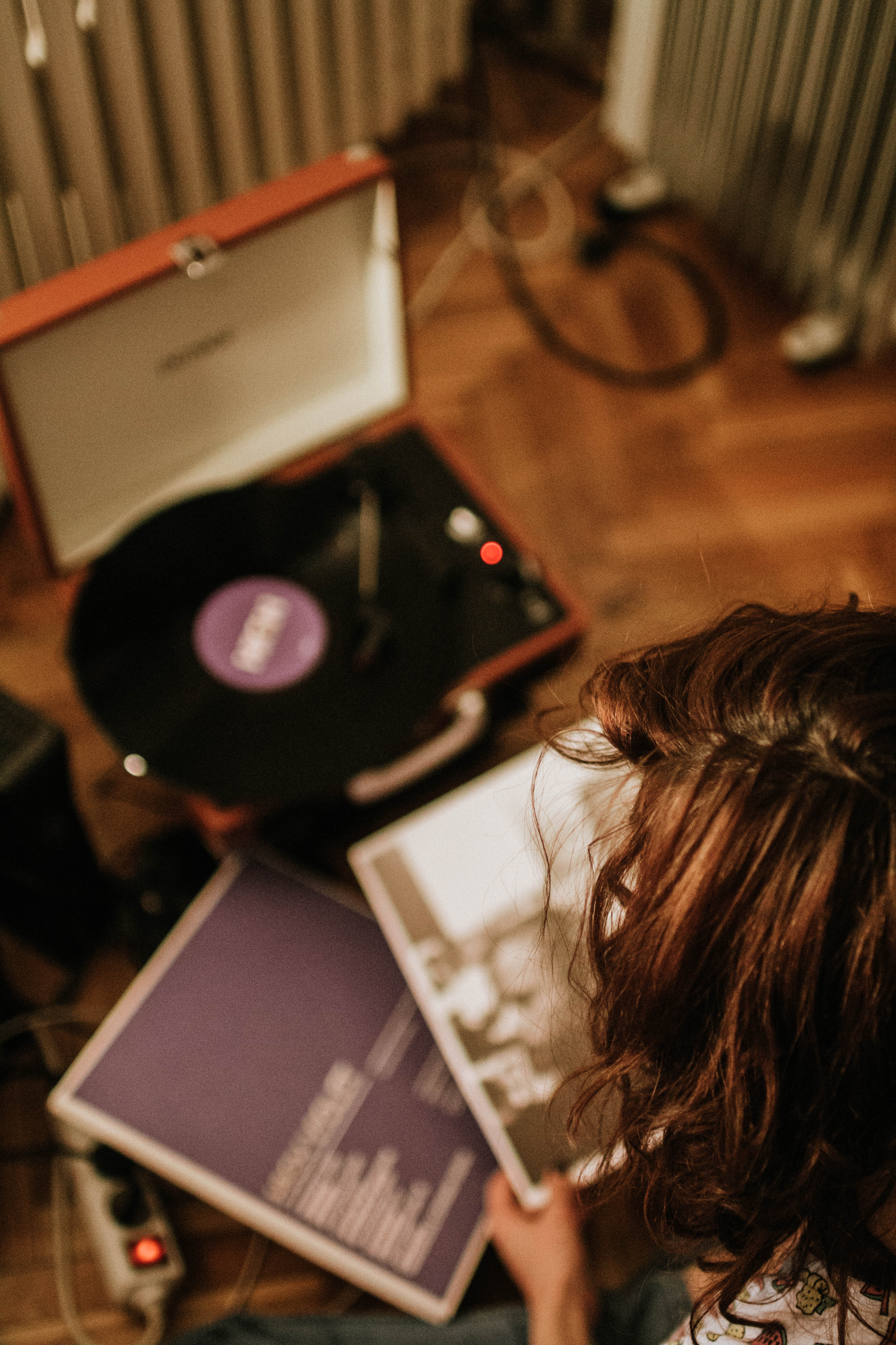 Person Holding Vinyl Sleeve