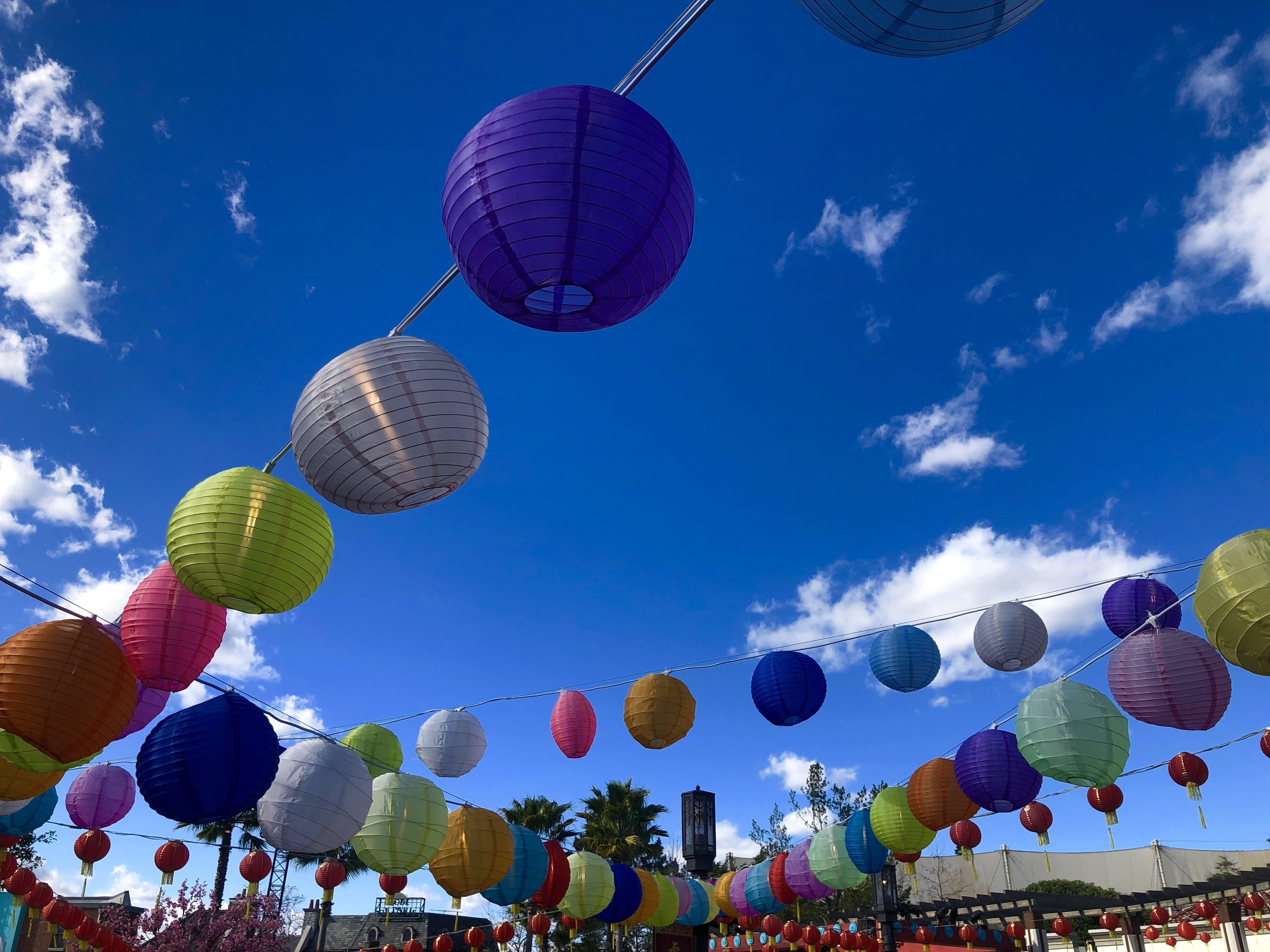 Free stock photo of blue sky, chinese lanterns, palm trees, paper lantern