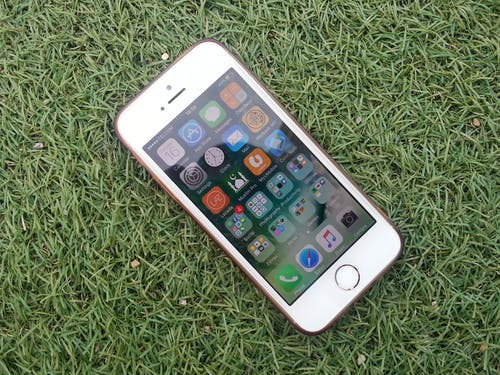 Silver Iphone on a Green Grass