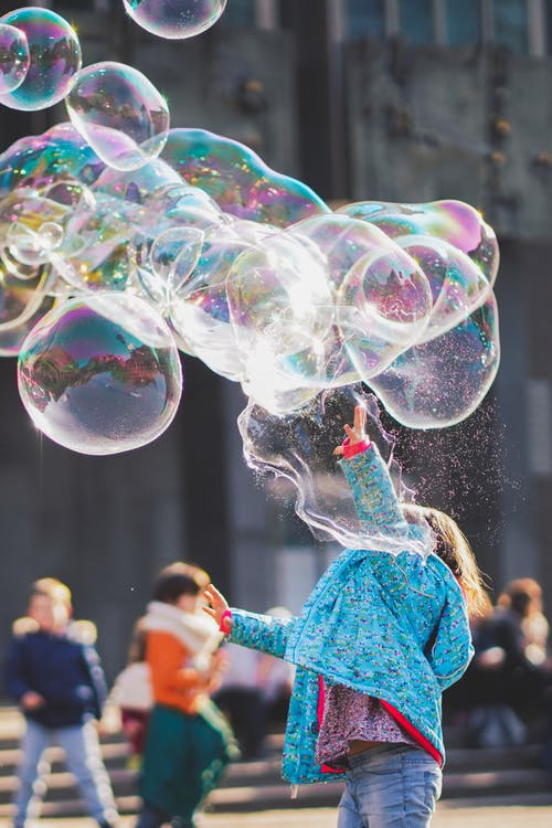 Girl Playing with Bubbles