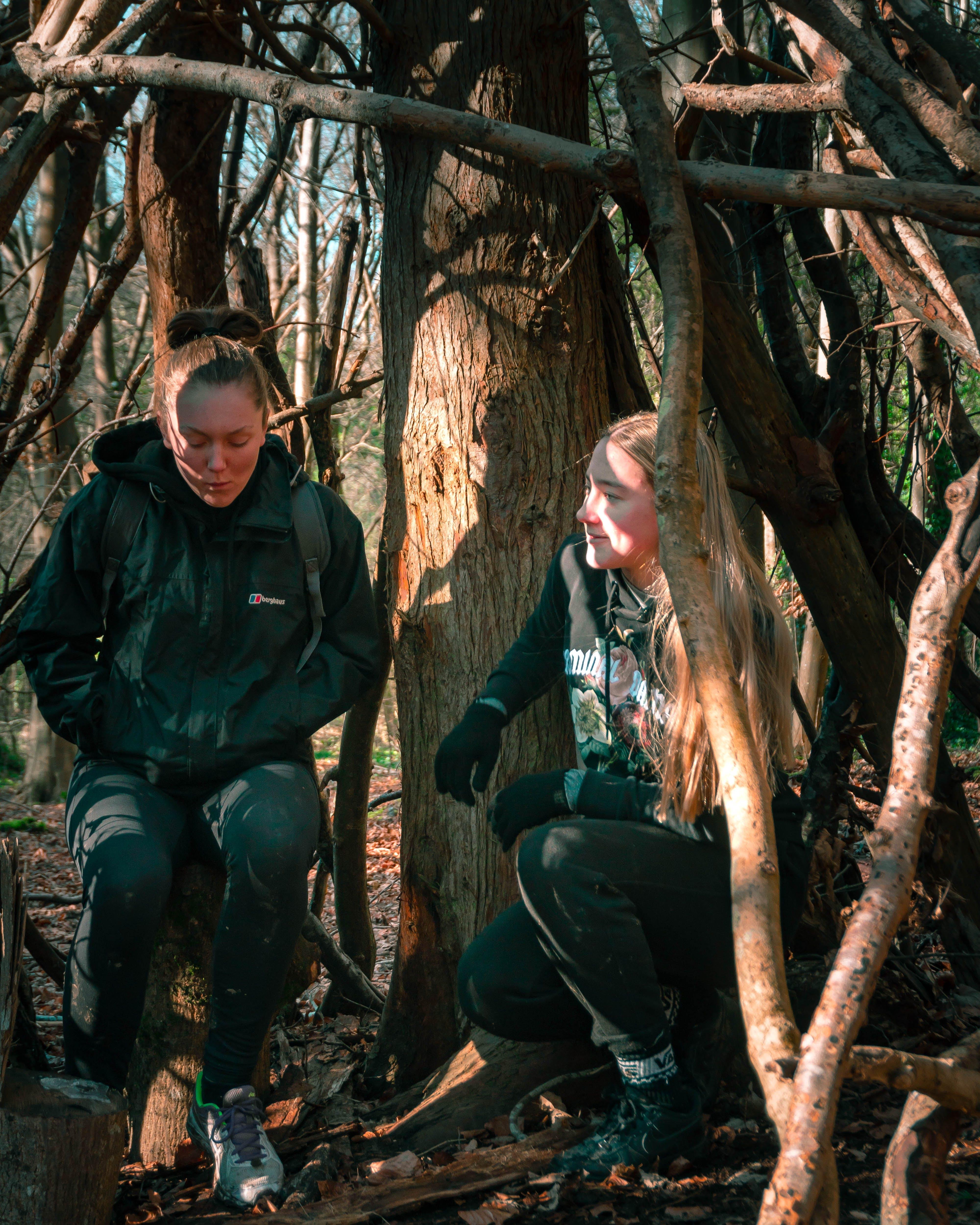 Women Sitting on Tree Barks