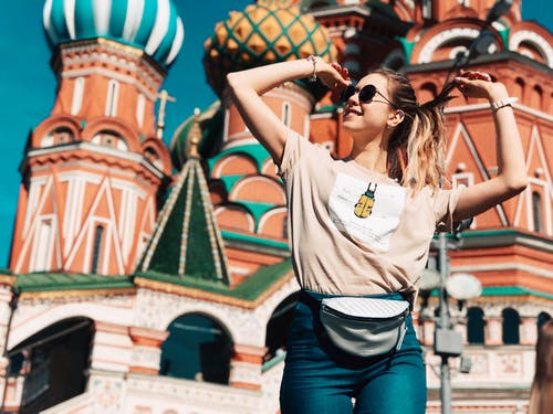 Photo of Woman Dancing With Saint Basil's Cathedral in Moscow, Russia in the Background