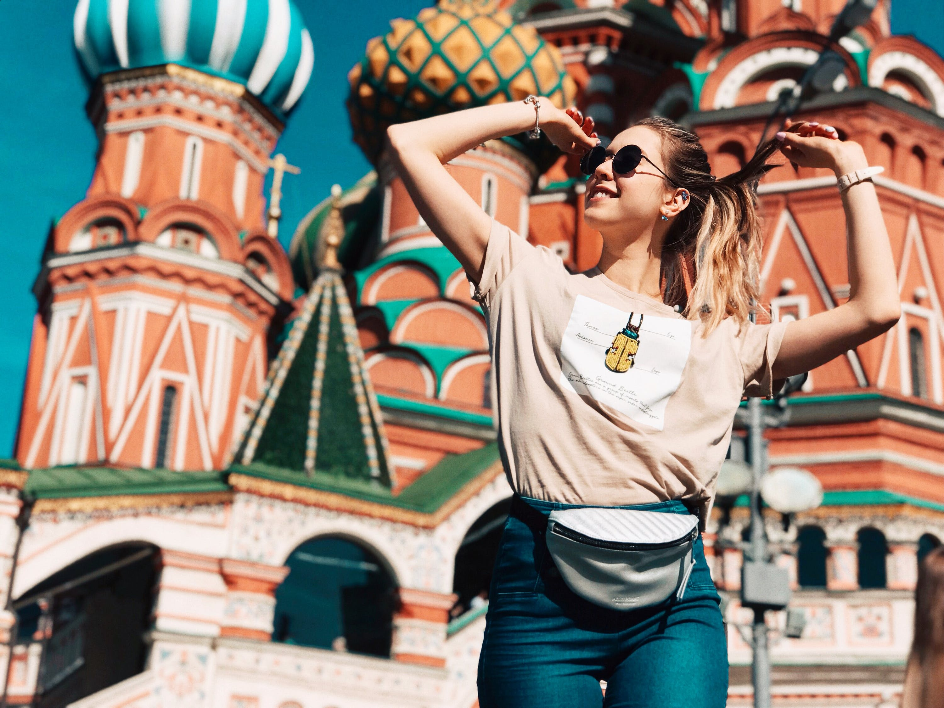 Photo of Woman Dancing With Saint Basil's Cathedral in Moscow, Russia in the Background - Russia Travel Guide