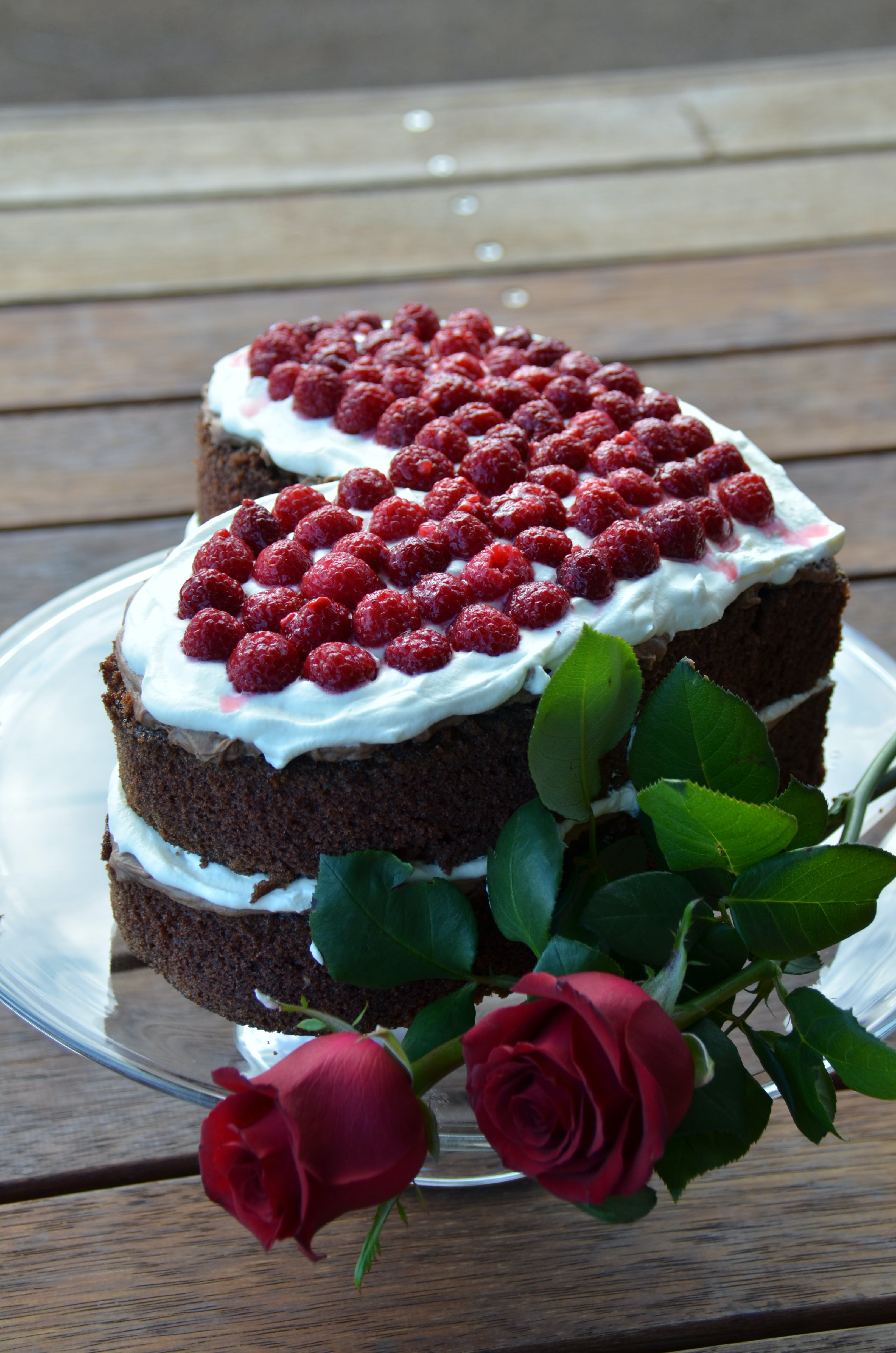 Free stock photo of heart shaped chocolate cake, red roses, valentine's day