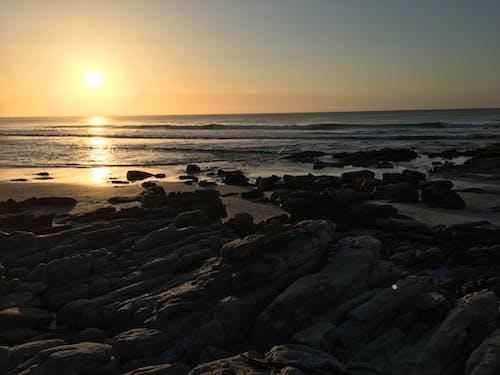 Foto stok gratis afrika selatan, batu, matahari terbenam, pantai