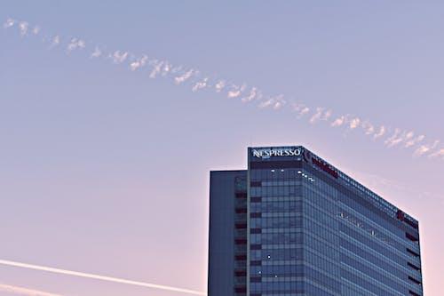 Ingyenes stockfotó ég, építészet, épület, felhők témában