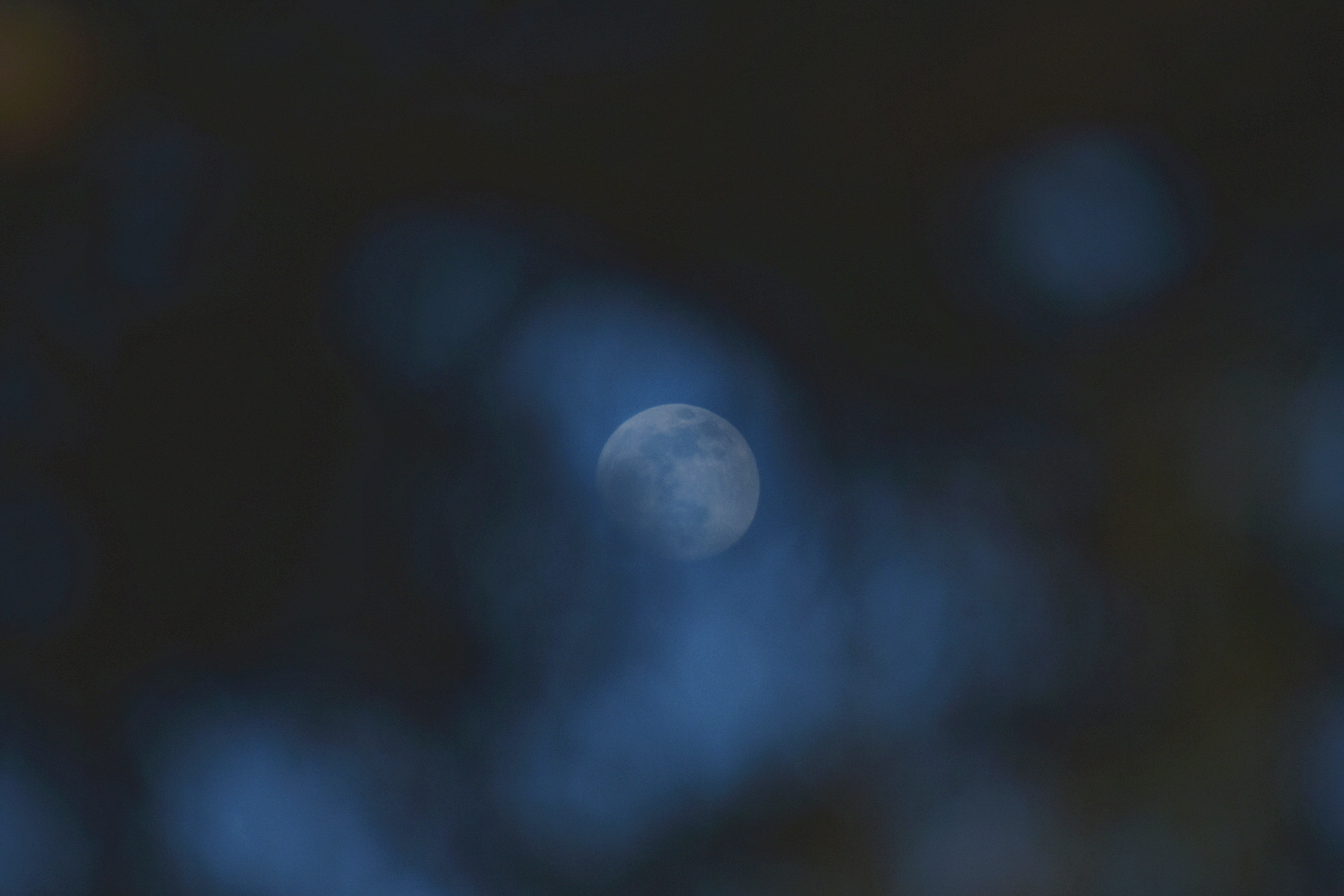 photo of full moon during night time