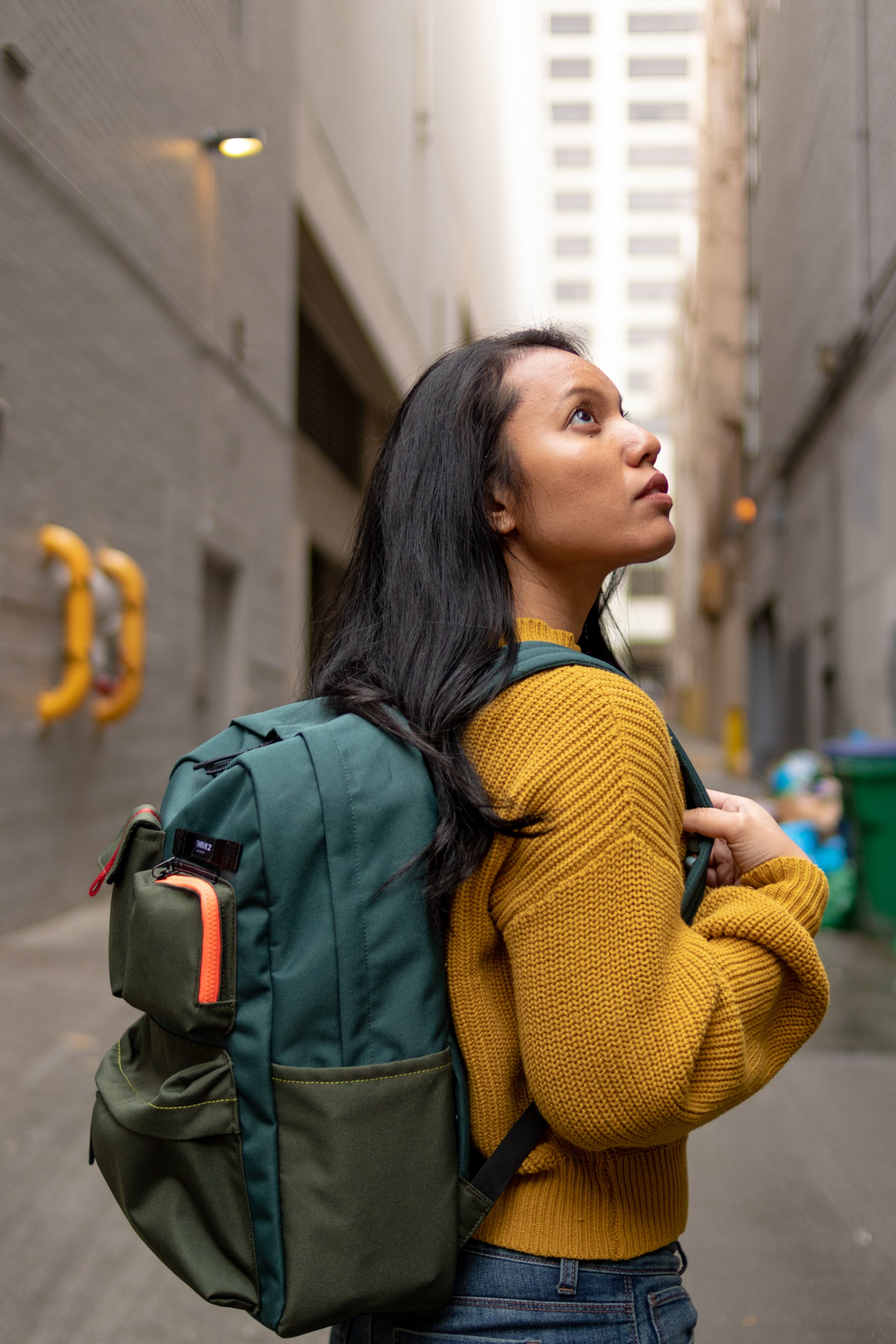 Woman Wearing Green Backpack