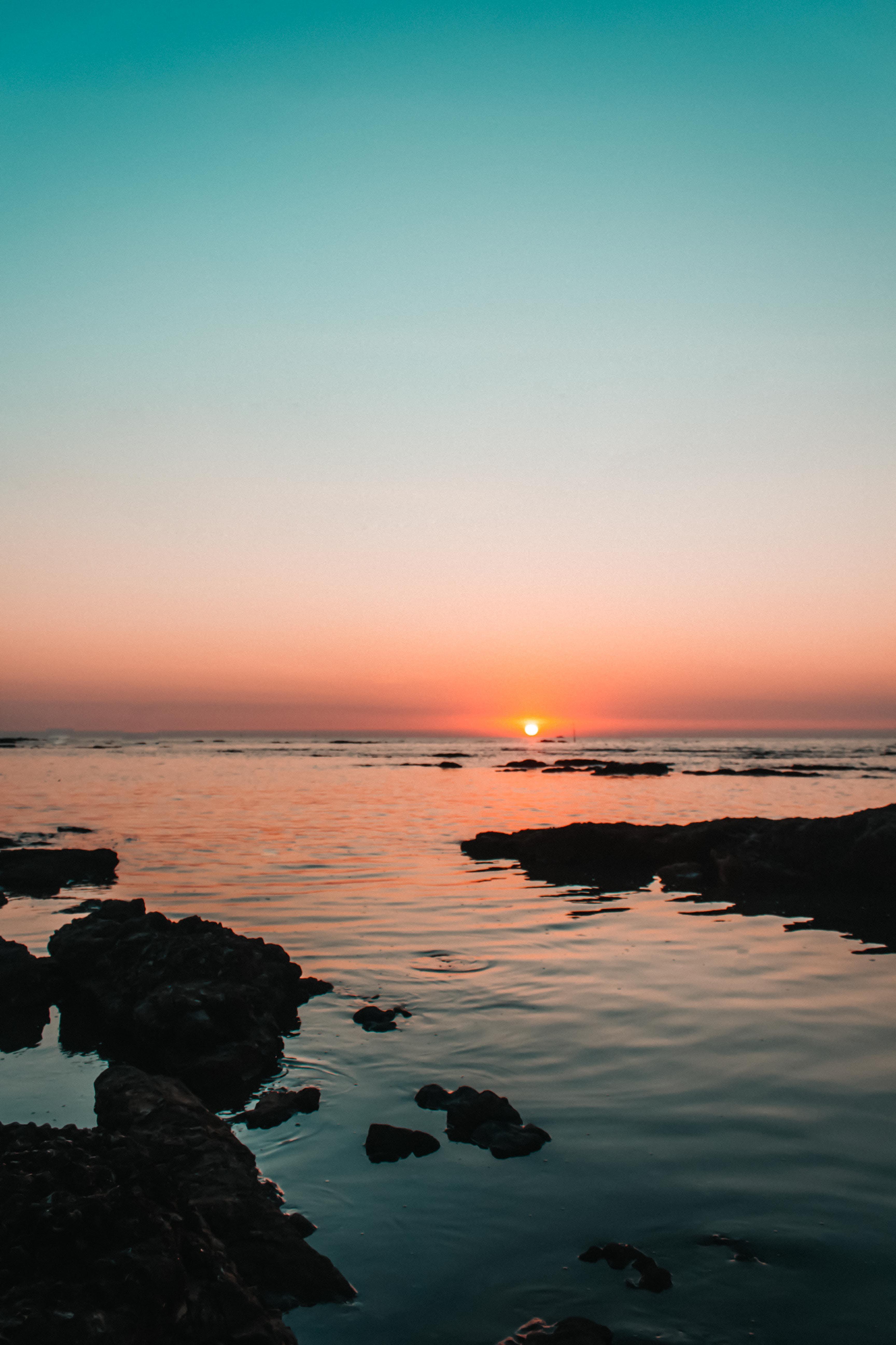 Free stock photo of beach sunset, blue water, sea, sunset