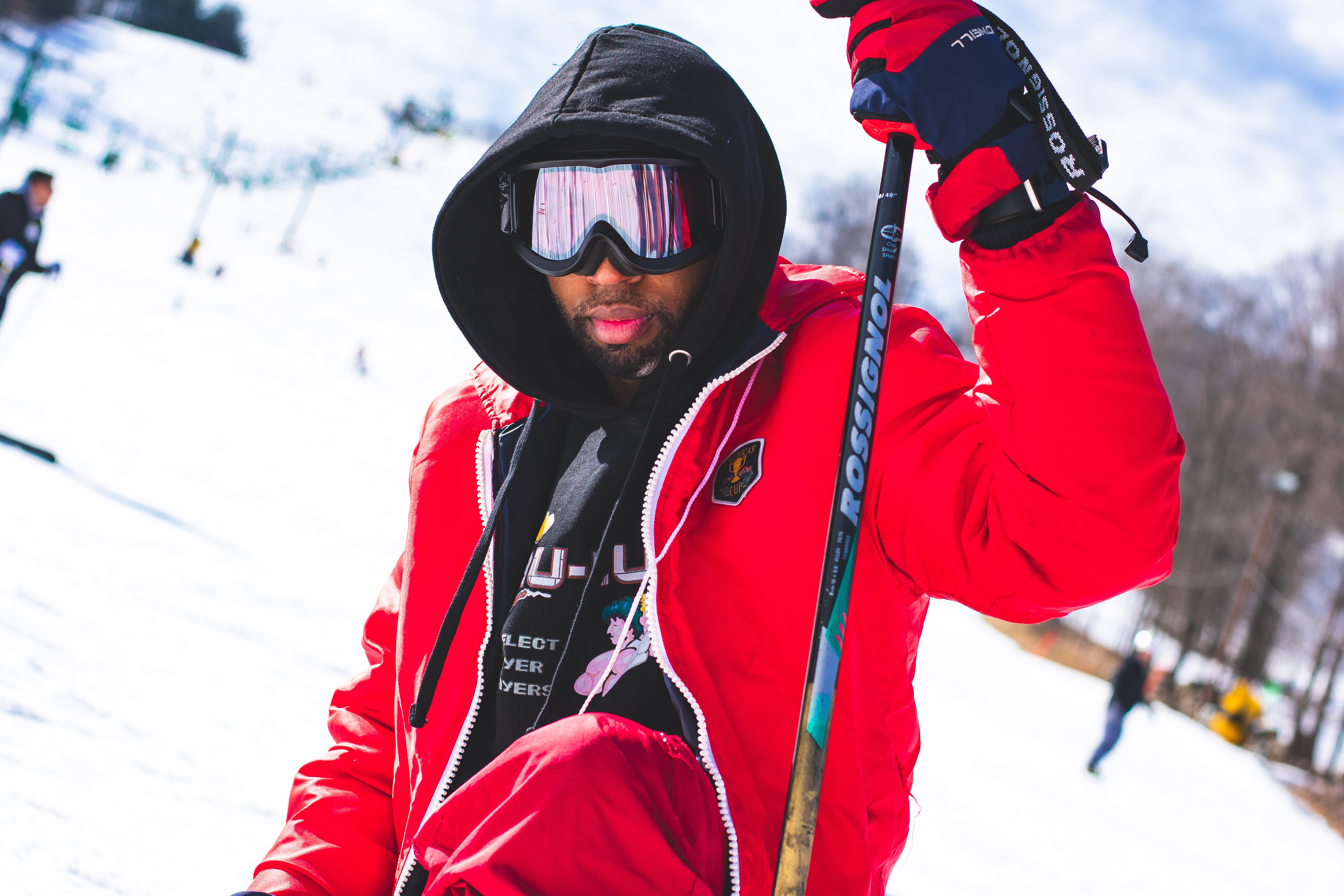 Man Wearing Googles and Holding Ski Pole