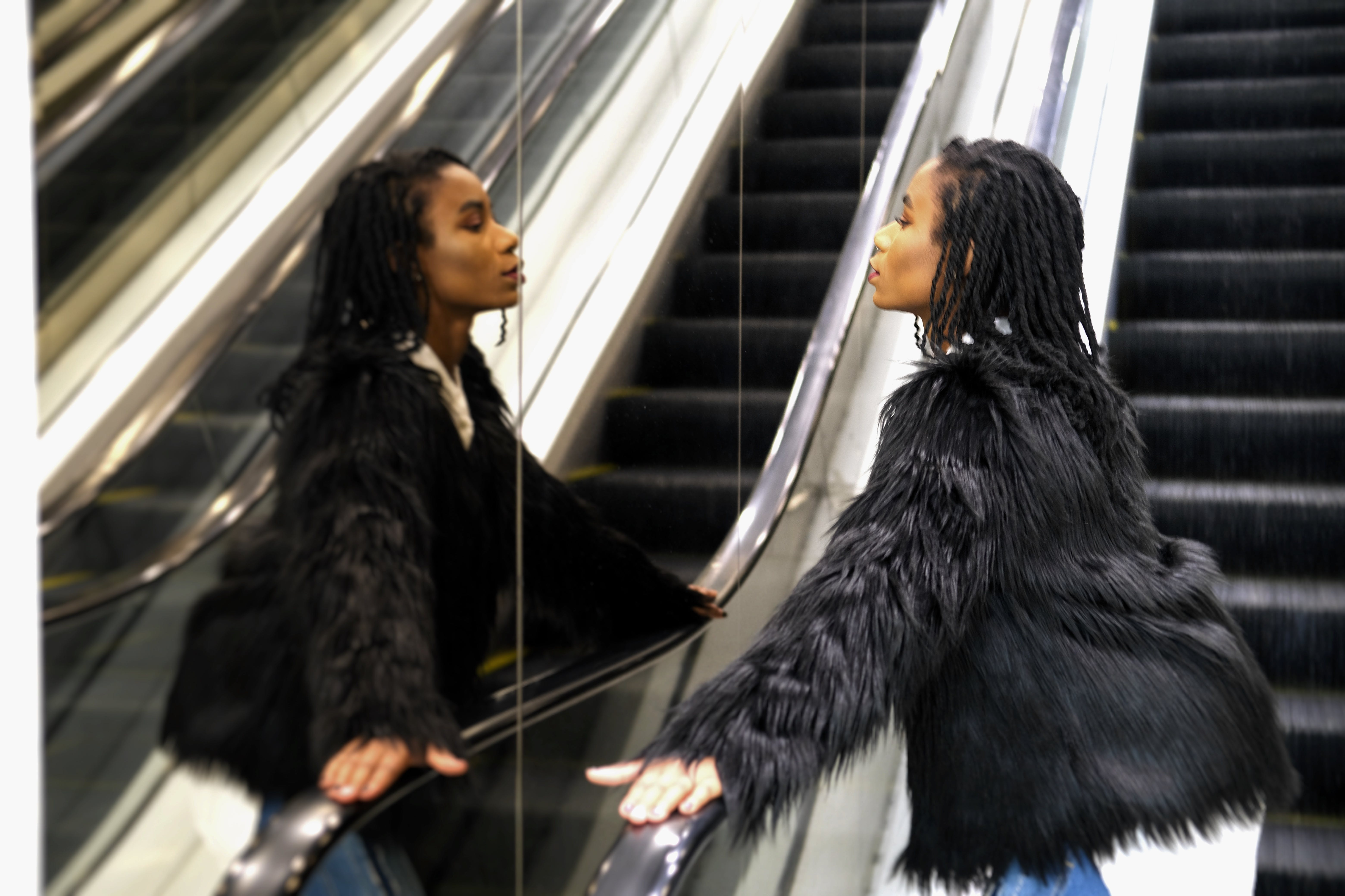 Free stock photo of african woman, black jacket, fur, in a