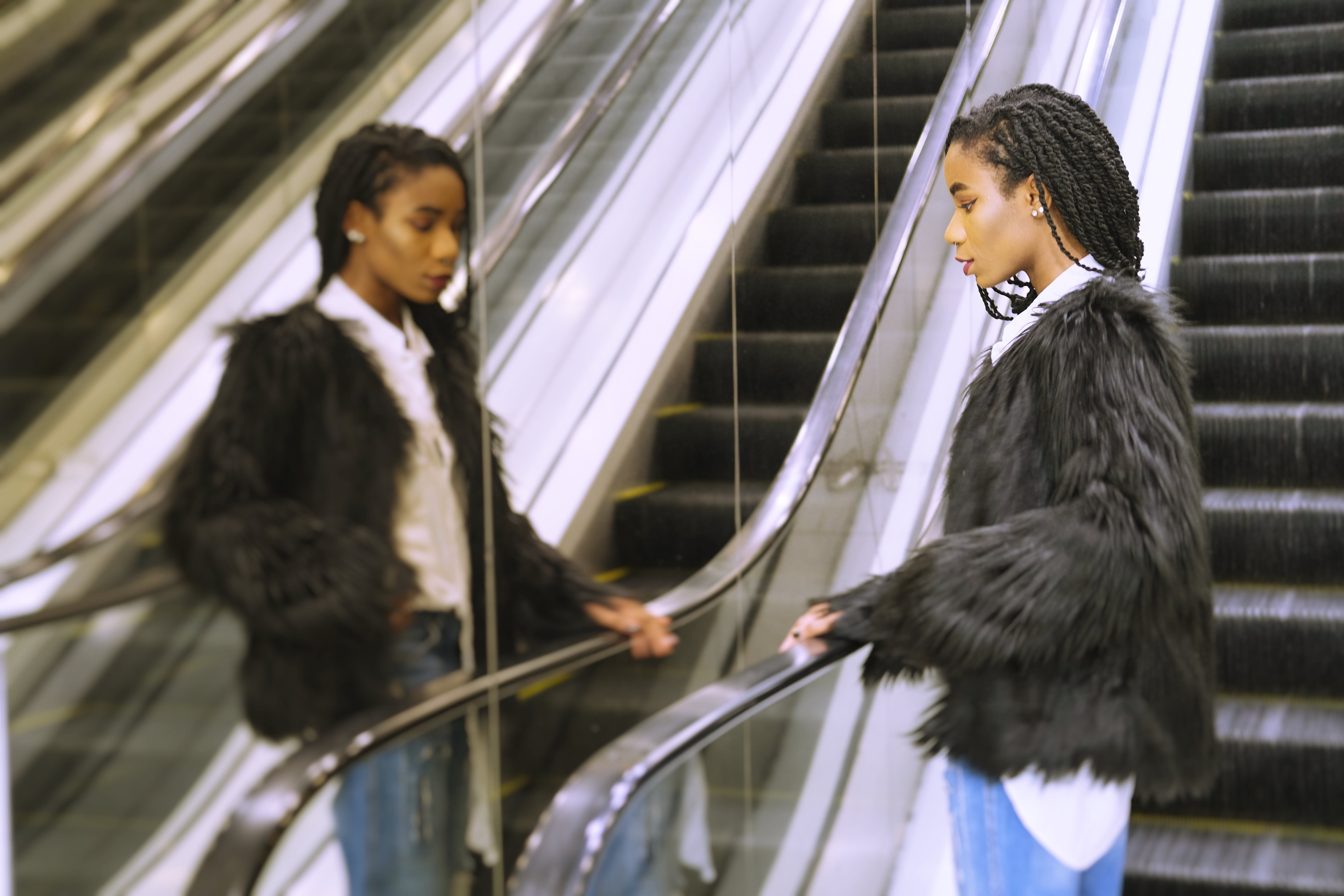 Free stock photo of black woman, escalator, in the, looking